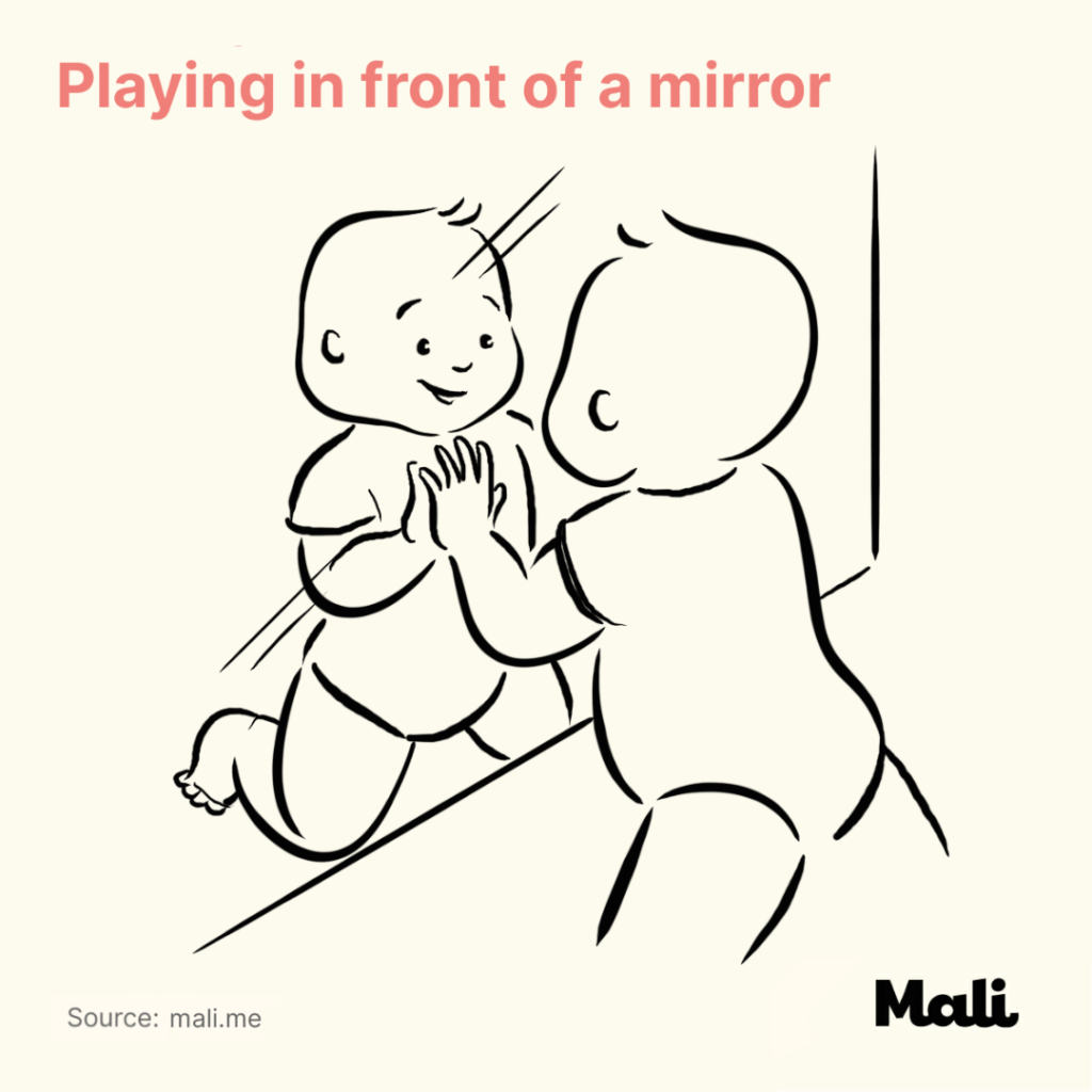 Playing in front of a mirror Five Ways to Encourage Crawling by Mali