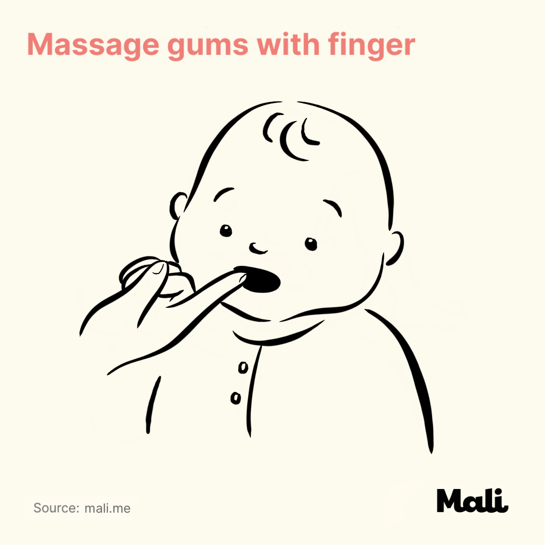 Massage gums with finger_5 ways to relieve teething-related pains by Mali