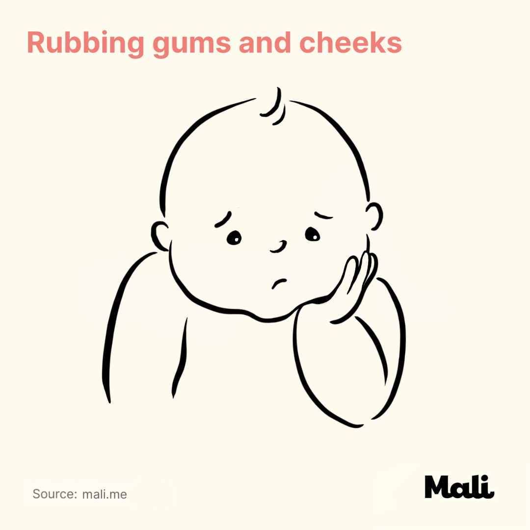 Rubbing gums and cheeks_6 ways to determine whether your baby is sick or teething? by Mali